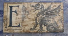 Personalized Vintage Advertising Art of Dragon with First Initial Letter-Wood Sign. $22.00, via Etsy.