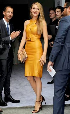 Blake in a mustard yellow leather dress at Milan Fashion Week