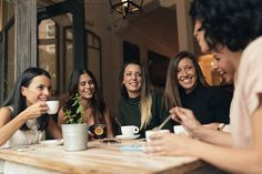 women drinking coffee in cafe bar. by nunezimage on @creativemarket