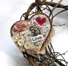 Valentine's Day grapevine wreath embellished with altered assemblage art. Country shabby chic!