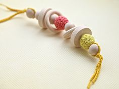 Coral and yellow big teething rattle for baby boy. by nihamaj