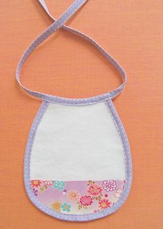 This darling little bib is made with Michael Miller Organic Fleece so it's as absorbent and soft as it is cute! The new Kokka Haikara makes a pretty and functional crumb catcher and best of all the whole thing comes together in less than an hour using our new Capitan 88 Linen Bias Tape, which is 100% linen and comes in a nice neutral palette. This would be a wonderful baby shower gift, you can whip up 3 or 4 of them in no time! Enjoy! --Molly