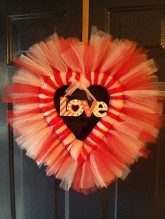 Crafts aren't just for kids! Look at this cute craft you can make for your house or classroom. Although this pin links only to a picture, it appears you can use mutli-colored tulle, a Styrofoam heart, and a hanging decoration in the center. It might be a fun project to work on during a cold night in!