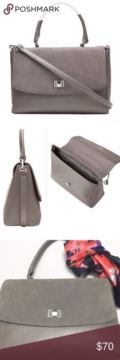 """Banana Republic Contrast City Bag Absolutely Beautiful Banana Republic Contrast City Bag.  🔹 Grey Suede 🔹Shell: 100% synthetic leather.  🔹 Trim: 100% Leather. 🔹Strap Drop: 21.6"""" 🔹 Twist Closure. 🔹Interior features: 1 zip pocket. Banana Republic Bags Satchels"""