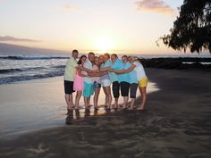 Nothing like a big family hug, with all 9, to showcase togetherness, on a Maui beach, at sunset. View more from this Maui family portrait photo shoot at: http://mauiislandportraits.com/family-portrait-maui-beach-sunset/