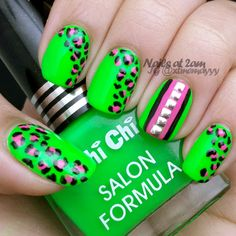 a neon green and pink leopard print nails.