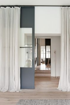 Floor to ceiling sheer curtains for wall of windows