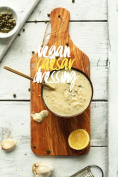 EASY 5-minute Vegan Caesar Dressing Ingredients 1/4 cup (60 g) plain hummus (store bought or DIY) 1 tsp spicy mustard 1/2 tsp lemon zest 2-3 Tbsp (30-45 ml) lemon juice, to taste 2 tsp capers, finely minced/smashed, plus 3 tsp brining juice 3 Tbsp fresh minced garlic (4-5 cloves) Healthy pinch each sea salt pepper to taste (more to taste) optional: 1-2 Tbsp (15-30 ml) olive oil (for added creaminess) optional: 1-2 tsp maple syrup
