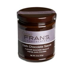Fran's creamy Dark Chocolate Sauce looks as delightful as it tastes in this elegant glass jar. Serve it over ice cream, with cake or as a dip for strawberries. Makes a great hostess gift. Made in Seattle, Washington.