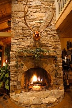 Antlers stacked stone fireplace