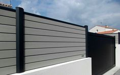 black composite fence in backyard, composite wood fence privacy design