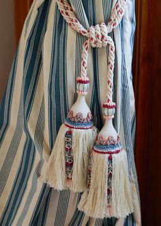 Delicate tassels tie the blue and white drapery. - Traditional Home ® / Photo: James Merrell / Design: Mark Gillette