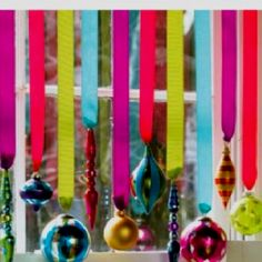 colorful bulbs hanging from colorful crepe paper
