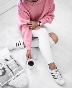 Pink ribbed sweater with white pants and adidas