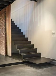 Plate steel stair cantilevered from wall.