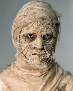 DIY mummy makeup: I would seriously do this and sit on the porch halloween night :)