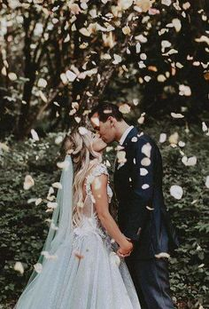 Weddings are all about kissing, but how not to look trivial? This is easy with our creative wedding kiss photos advice. Experiment with photo settings and story to make your perfect image of a… Slip Wedding Dress, Rain Wedding, Wedding Scene, Wedding Kiss, Wedding Bride, Wedding Punch, Party Wedding, Bride Groom, Wedding Hair
