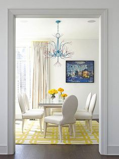 Like the chairs in this room's clean, modern aesthetic. Matching white chairs and table are outfitted with nailhead trim for an upscale look. The turquoise and red chandelier adds color overhead. Yellow Carpet, White Carpet, Yellow Rug, Yellow Walls, Dark Carpet, Yellow Accents, Color Accents, Gray Yellow, Wool Carpet
