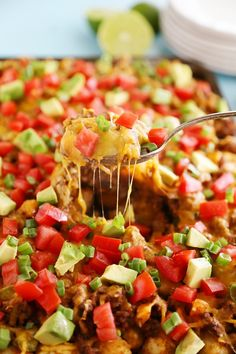 Cheesy Loaded Nacho Tater Tots – So easy, so cheesy and loaded with all the good stuff. Perfect for game day snacking!