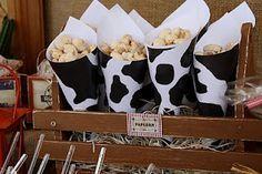 Popcorn cones in cow paper cones. (Dulce Design: Cowboy Party)