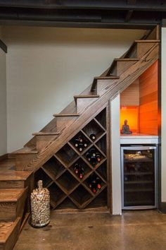 Wine Rack solution - conserve space by utilizing your staircase for storage! Wine Rack solution - conserve space by utilizing your staircase for storage! Bar Under Stairs, Under Stairs Wine Cellar, Wine Cellar Basement, Basement Makeover, Basement Renovations, Home Renovation, Home Stairs Design, House Design, Staircase Storage