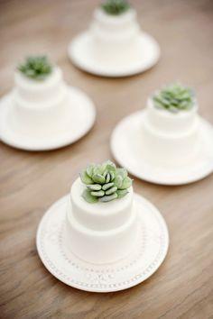 mini cakes topped with succulents, photo by Christa Elyce http://ruffledblog.com/eco-friendly-garden-wedding-ideas #weddingcake #succulents #minicakes