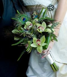 Bridal bouquet of orchids and peacock feathers