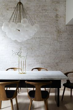 See How This NYC Apartment Went from Lackluster to Light-Filled,brick wall painted white behind a marble dining room table and contemporary chandelier The best chandelier is the main one with adjustable heigh. Dining Room Walls, Dining Room Sets, Dining Room Design, Dining Room Furniture, Room Chairs, Furniture Ideas, Office Chairs, White Dining Room Table, Painted Dining Chairs