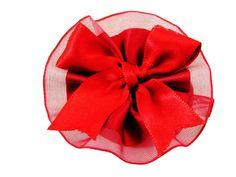 Scatolina cartoncino ovale con coccarda rossa e confetti a scelta.
