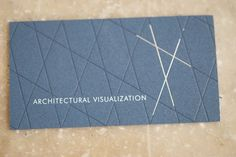"Via Evolution Press: ""The architectural lines are letter-pressed to provide a both impression and elevation within the soft cotton stock. Production included offsetting pms 2965 on179# Cranes Crest, the architectural lines were letter-pressed in pms 2965 and followed up with a foil pass in matte silver. The flip side of the card was letterpress in pms 2965 and pms 877 with a final treatment of silver gilding."""