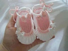 .pink and white baby shoes