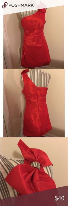 Beautiful One Shoulder Red Formal Bow Short Dress Beautiful red colored dress that is a light material to be more fitted to the body. Has a beautiful red bow accented with a silver and rhinestone accent in the middle of the bow that sits on the shoulder. Great for prom, Formal, semi formal, or a wedding! Worn once, no rips or stains, in great condition! Fiesta Dresses One Shoulder