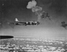 JUL 29 1944 A B-17 Flying Fortress encounters heavy flak bursts over the target area.