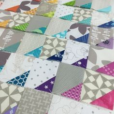 """I had this flash of an idea in my head recently and I knew I wanted to sew it up. Immediately if possible. The idea was a low volume quilt with rainbow """"bites"""" throughout the patchwork. There was"""