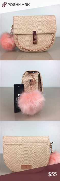 💥New 💥BCBG Broken Arrow Croc Cross Body in Blush Attached partial chain shoulder strap. Foldover flap with dual option turn-lock closure. Exterior features front chain embellishment, detachable pompom detail, and textured detail. Interior features 1 zip wall pocket. Approx. 6 H x 8 W x 3 D. Approx. 23 strap drop. Imported BCBG Bags Crossbody Bags