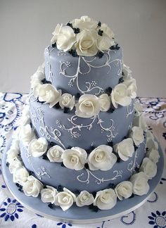 wedding cake...i like the roses in between layers, pretty. but not a blue cake