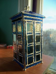 While attending a stained glass class, Craftster user and Doctor Who fan Xandrigirly decided to create her very own stained glass TARDIS