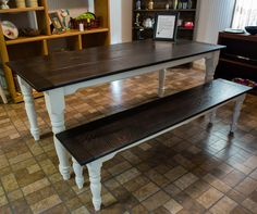 Garvinworks custom farmhouse rustic dining or kitchen table with matching bench. Hand-turned spindle legs, oak tops treated for a dark patina.