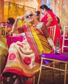 Rain on your wedding day | cool indian grandmother at a wedding | Monsoon Wedding ideas | Candid shots | Indian Wedding Photography | Photo Credits: Shades Photography | Every Indian bride's Fav. Wedding E-magazine to read.Here for any marriage advice you need | www.wittyvows.com shares things no one tells brides, covers real weddings, ideas, inspirations, design trends and the right vendors, candid photographers etc.