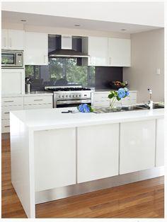 Crisp white kitchen with a charcoal splash back. Gorgeous!