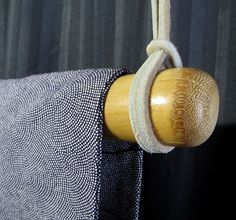 Simple and elegant natural bamboo rod in a natural finish makes it easy to display your favorite obi or one of our kimono tapestries.  Offered in a natural colored bamboo, with a smooth, glossy finish. Photos show examples of both our Natural and Black color option, click here to see our Black option:  https://www.etsy.com/shop/kyotokimono/search?search_query=rod&order=date_desc&view_type=list&ref=shop_search. Sometimes we are sold out, but you can email us for an estimated restock date…
