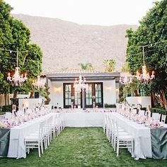 Brides.com: An Outdoor Wedding at the Viceroy Palm Springs. The couple's cool color palette was easily carried through to the reception where metallic runners were placed on long, rectangular banquet tables arranged in a u-shape. Chandeliers were hung over the dining area.