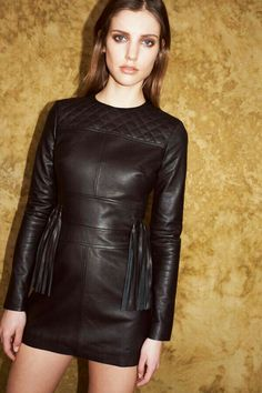 Quilted long sleeve black leather minidress with fringe