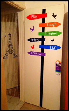 Cool Art Design_Homes / Our sign post installed on a  bedroom door with our Paris Eiffel Tower wall decal in the background.