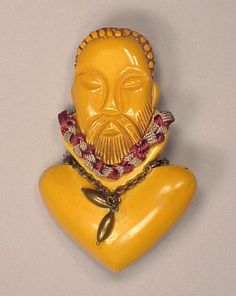 Bakelite Heraldic Brooch Depicting a bust of a Bishop Height 3 inches.  Sold for $250