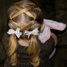 Lace-up her hair :) I used to do this to the girls when they where little.  it is so cute