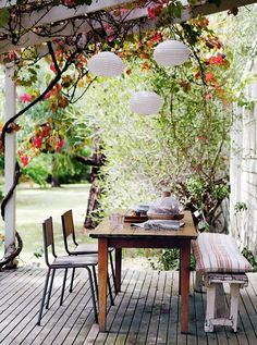 pergola + paper lanterns + flowering vines + great vintage furniture. I'd take this patio any day! #deck #terrace