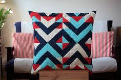 To start, a patchwork pillow inspired by dazzle camouflage