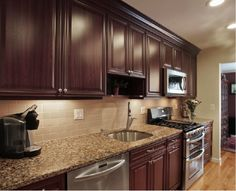 Stone Backsplash Dark Cabinets kitchen makeover reveal | happy, kitchen colors and wood cabinets