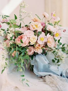Pink and blue wedding bouquet to die for.